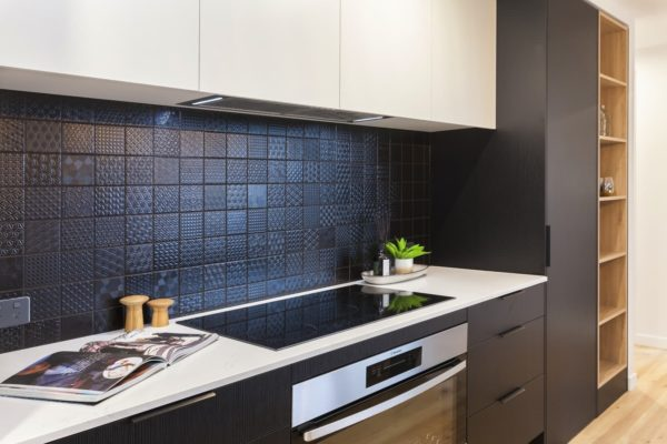 Bishop Street new build kitchen with black tiling in Canterbury built by Forbes Residential