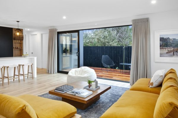 Living room leading out to deck built by Forbes Residential at the Bishop Street new build in Canterbury