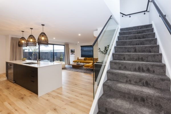 Carpet staircase leading to kitchen in the Bishop Street new build built by Forbes Residential nz