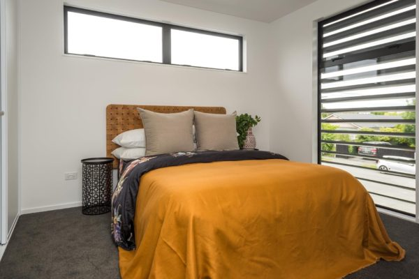 Forbes Residential Edgeware townhouses Canterbury finished bedroom with bed and view outside through window