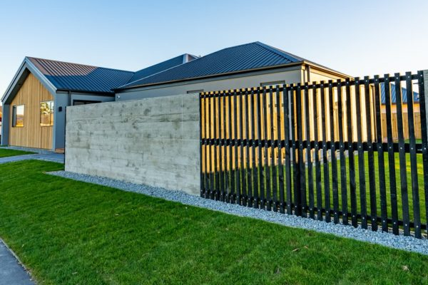 Forbes Residential Two Roads New Build Canterbury look over to house from wooden fence