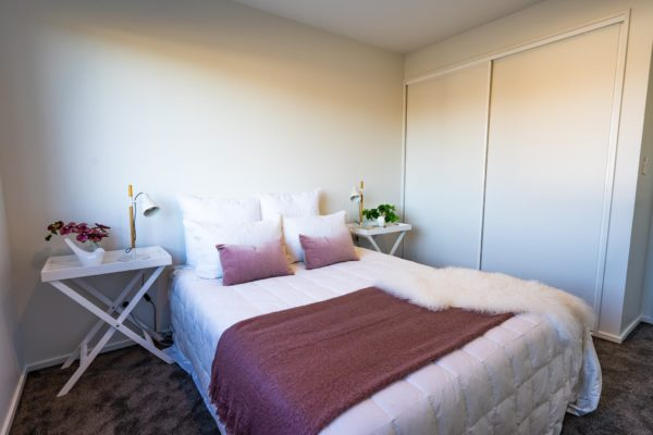 Forbes Residential Two Roads new build nz bedroom with white and pink theme