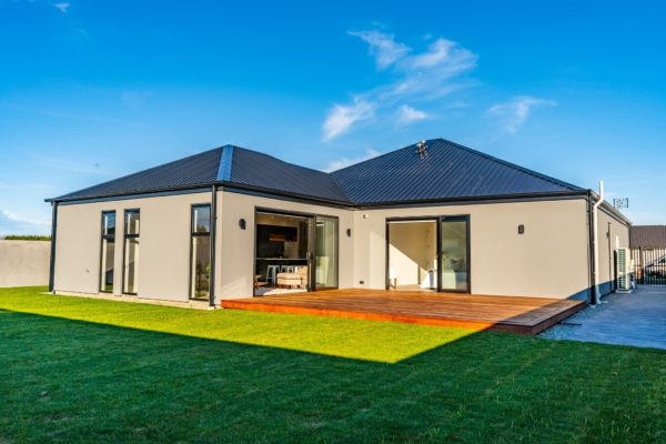Forbes Residential Two Roads new build NZ deck and house and grassy backyard