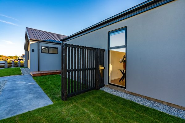Forbes Residential Two Roads new build Christchurch view of black fence and window on house